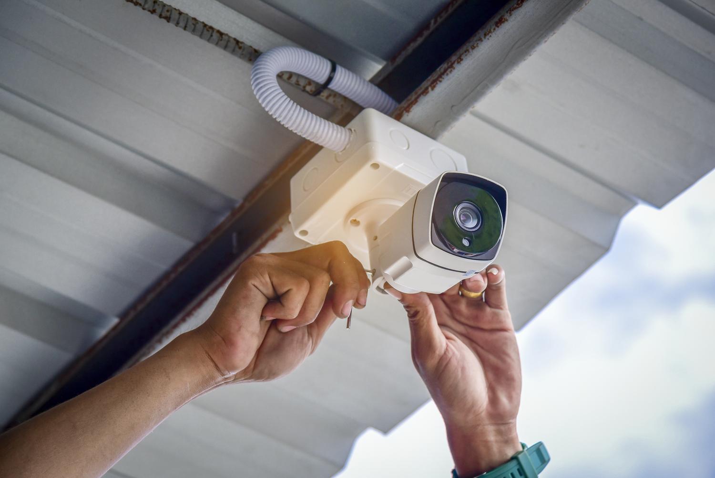 Technician installing CCTV Camera